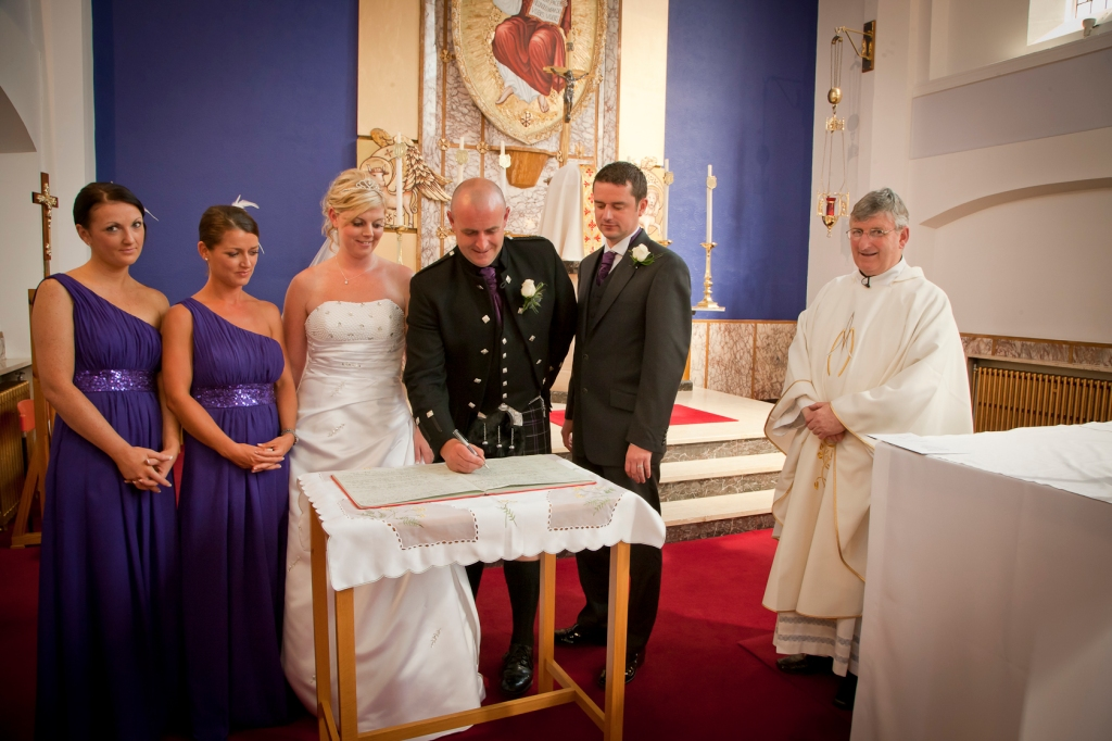 Signing the register at St Marys Church, Hamilton